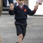 George looked a little nervous arriving at the school gates Photo PA