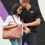 Harry and Meghan were openly affectionate at the Toronto Games Photo (C) GETTY IMAGES
