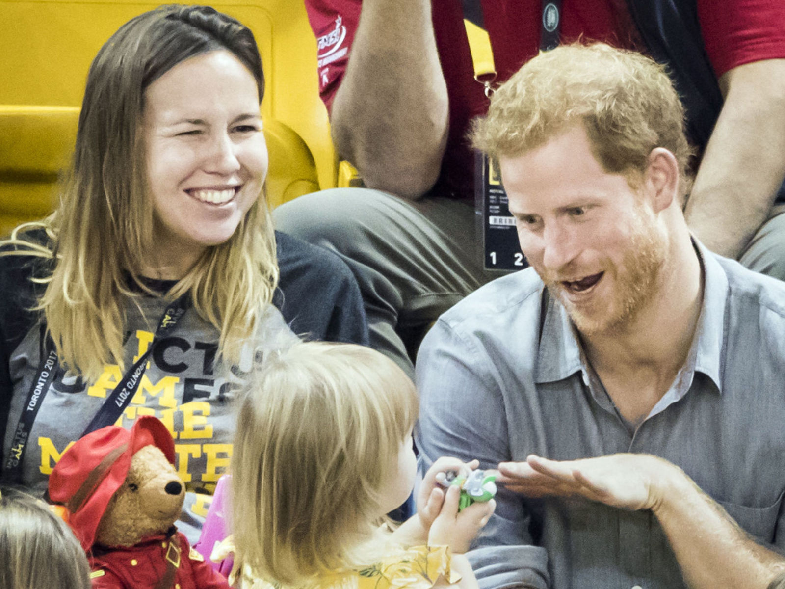 Prince Harry made a new friend at the Invictus Games last night but it appeared two-year-old Emily Henson was only after one thing: his popcorn. Prince Harry has been making many appearances at the Invictus Games this week, including one with his girlfriend Meghan Markle. This was their first public appearance together and has resulted in many engagement rumors.