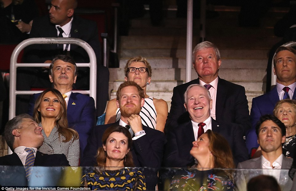 Instead of his girlfriend, Harry had First Lady Melania Trump seated next to him in the royal box. They sat behind Ukrainian President Petro Poroshenko