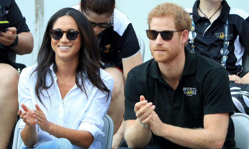 Is there an engagement on the cards Prince Harry and Meghan Markle's body language revealed by expert Photo (C) GETTY