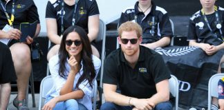 Meghan kept a protective guard with her legs crossed during her debut public appearance with Harry Photo C GETTY