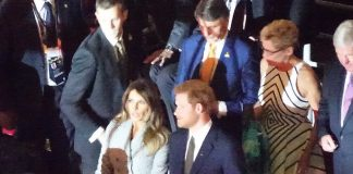 Melania and Harry exchanged small talk before taking their seats as the games got underway on Saturday night