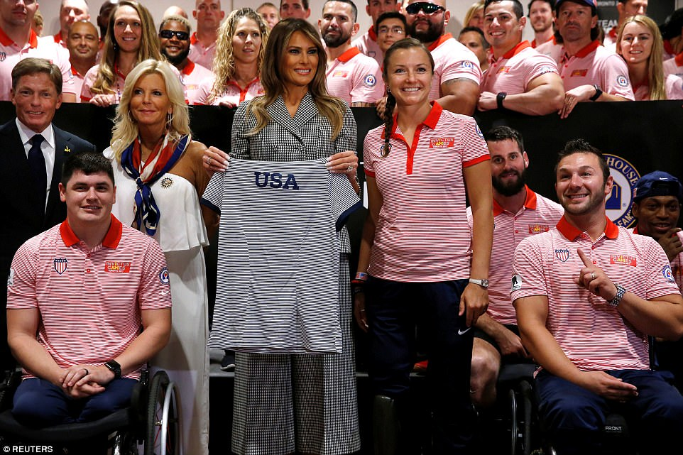 Melania greets members of Team USA prior to the opening ceremony of the games; Michelle Obama championed the games