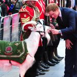 File photo dated 10/06/14 of Prince Harry petting Lance Corporal Shenkin III, which has died aged seven. PRESS ASSOCIATION Photo. Issue date: Wednesday September 27, 2017. See PA story DEFENCE Goat. Photo credit should read: Ian West/PA Wire