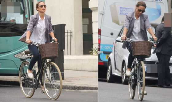 Middleton looked effortlessly chic as she peddled her way through the streets while wearing a gray blazer Photo C GETTY
