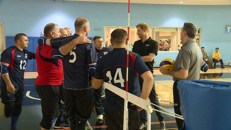 Prince Harry met the Georgian sitting volleyball team, including their British coach, Rich Osborne (right). Photo (C) GETTY