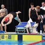 The British swim team member one of the hundreds of athletes taking part in the games in Toronto was closely inspected by the prince and other team officials and members