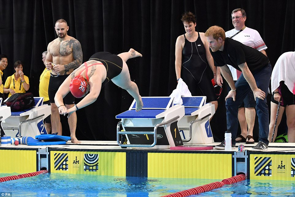 The British swim team member, one of the hundreds of athletes taking part in the games in Toronto, was closely inspected by the prince and other team officials and members