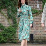 The Duchess Kate wore a green poppy print Prada dress to the Diana memorial Photo C GETTY