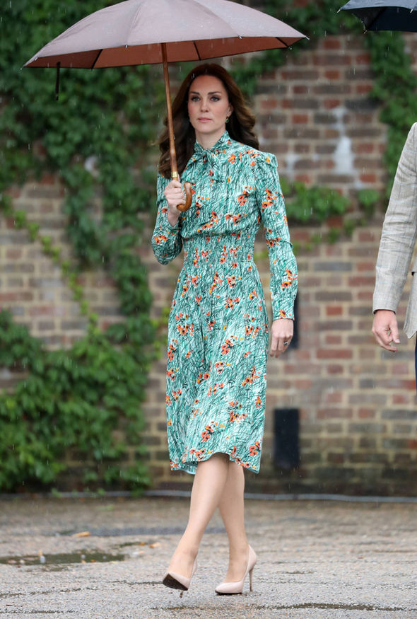 The Duchess, Kate wore a green poppy print Prada dress to the Diana memorial Photo (C) GETTY
