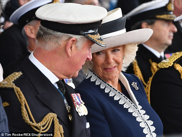 The Duchess of Cornwall smashed a bottle of malt whisky over the Prince of Wales yesterday and several thousand people burst into applause – led by the prince himself