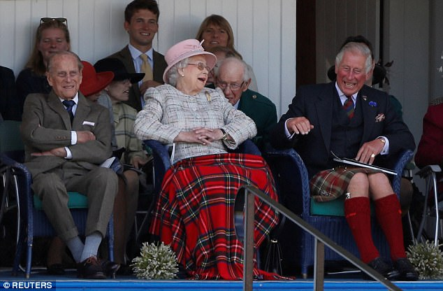 The Queen (centre) was joined by Prince Philip (left) and Prince Charles (right) at the Braemar Gathering in Scotland
