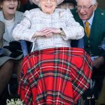 The Queen wore a pink hat and a feather broach as she watched Braemar Gathering in Scotland and kept warm under a tartan blanket