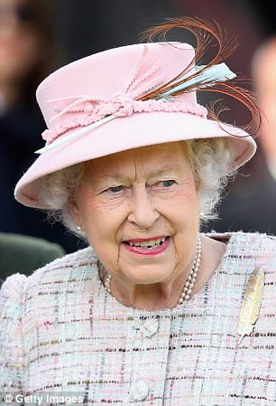 The Queen wore a pink hat and a feather broach as she watched Braemar Gathering in Scotland