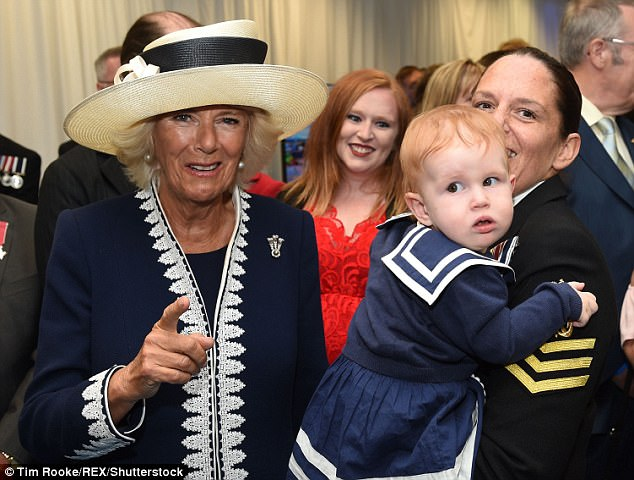 The duchess (pictured at the event) welcomed a gallant trio of the survivors yesterday