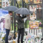 William and Harry take a look at Diana's tributes from the fans Photo C GETTY