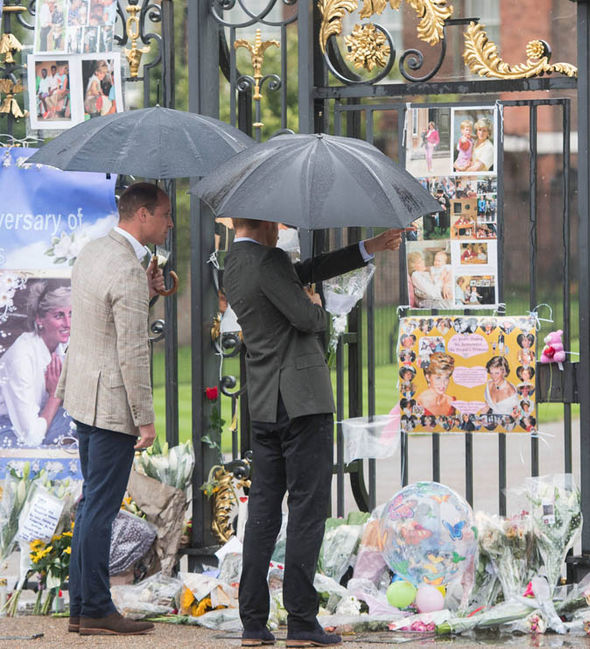 William and Harry take a look at Diana's tributes from the fans Photo (C) GETTY