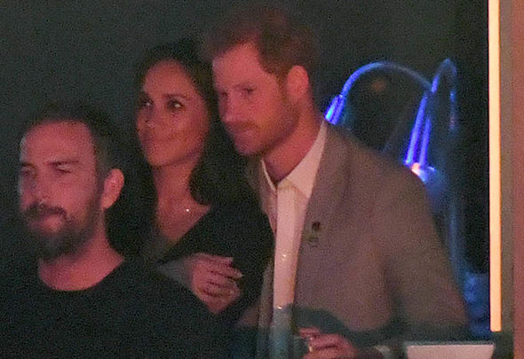 Prince Harry gave Meghan Markle a cheeky kiss during the closing ceremony in Toronto Photo (C) WIREIMAGE
