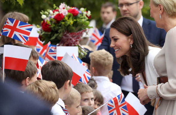 A beaming Kate greets crowds in Warsaw Photo (C) GETTY