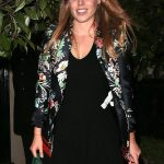 Beatrice wore a short black dress with a floral bomber jacket over the top and black heels