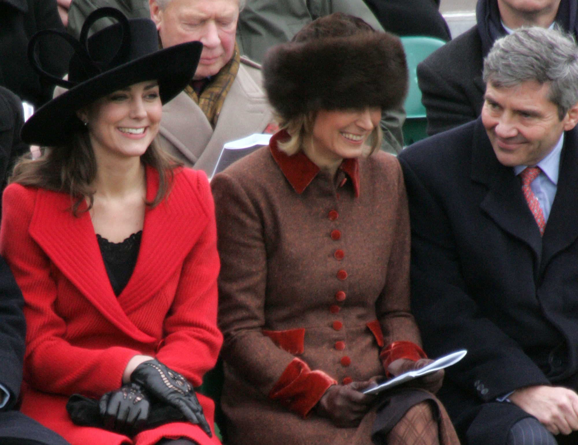 Prince William's girlfriend Kate Middleton (l) with her mother Carole and father Michael (r) at the parade ground at the Royal Military College, Sandhurst, for today's Sovereign's parade.   (Photo by Tim Ockenden/PA Images via Getty Images)