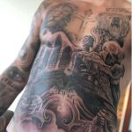 Dark images The inking includes gothic gargoyles. skeletons and archways that completely covers his chest and abs