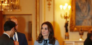 Duchess Kate looked stunning in a blue lace Temperley dress Photo (C) GETTY