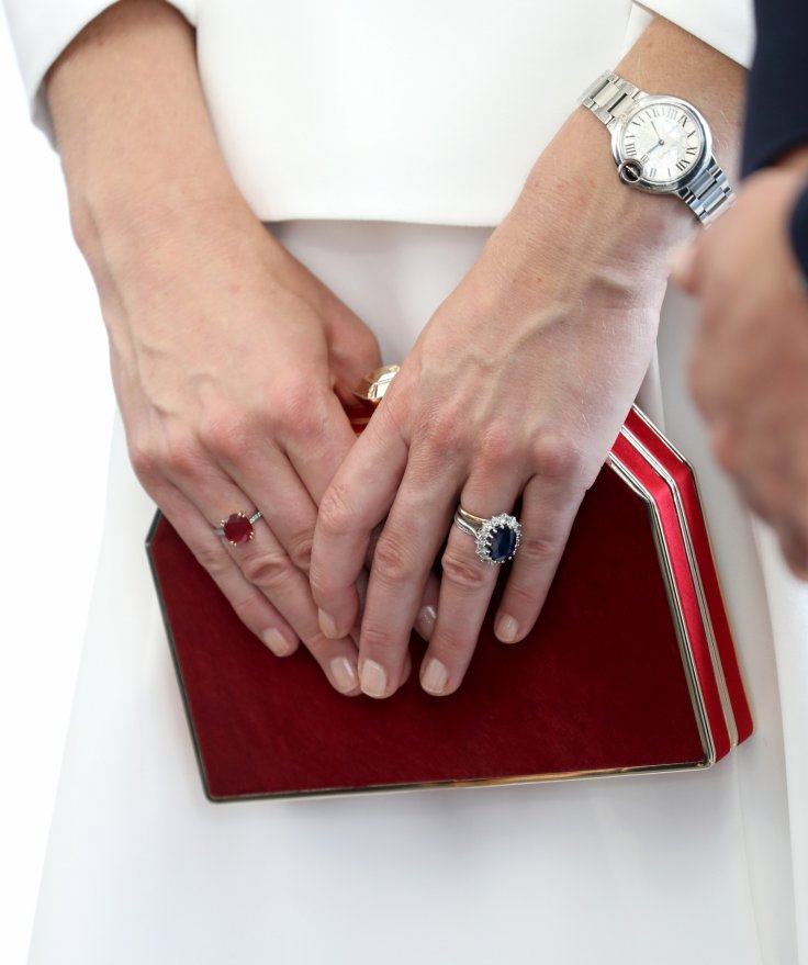 Duchess of Cambridge is known for her elegant jewelry, including her Cartier watch and sapphire engagement ring that originally belonged to Princess Diana Photo (C) Getty