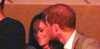 Harry plants a kiss on Meghans cheek as the watch the Invictus Games closing ceremony