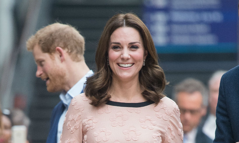 Kate dresses for pregnancy in 'practical' £335 heels Photo (C) GETTY