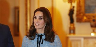 Kate dresses tiny bump in Temperley dress at palace reception Photo (C) GETTY