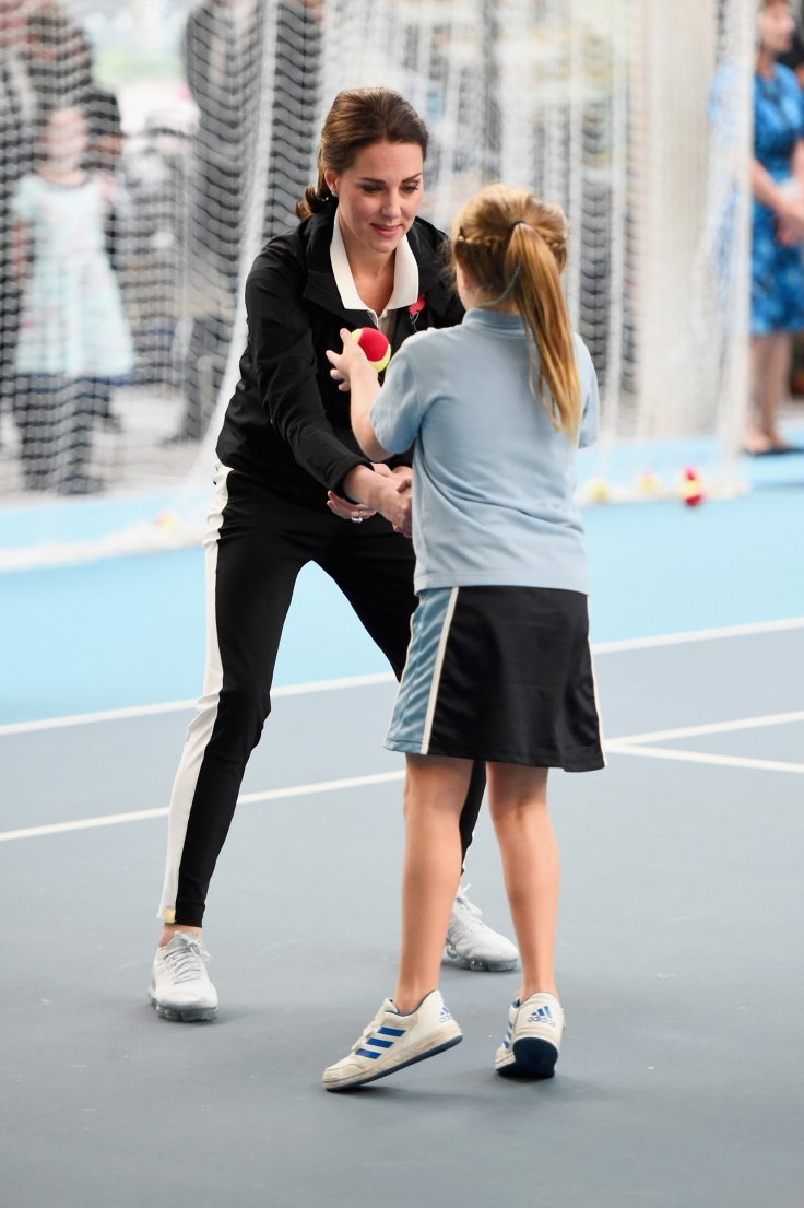 Kate enjoying some tennis activities with a little girl at the National Tennis Centre Getty