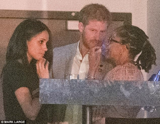 Meghan with Harry and her mother Doria at last month's Invictus Games
