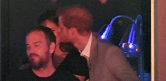 Prince Harry gave Meghan Markle a cheeky kiss during the closing ceremony in Toronto Photo C WIREIMAGE