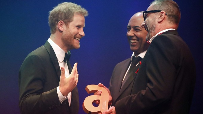Prince Harry receives a posthumous Legacy award on behalf of his mother Diana, Princess of Wales, from Ian Walker, (right) and Julian La Bastide. Credit PA