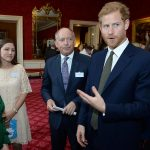 Prince Harry speaks to guests at St James Palace at a reception to mark World Mental Health Day. PA