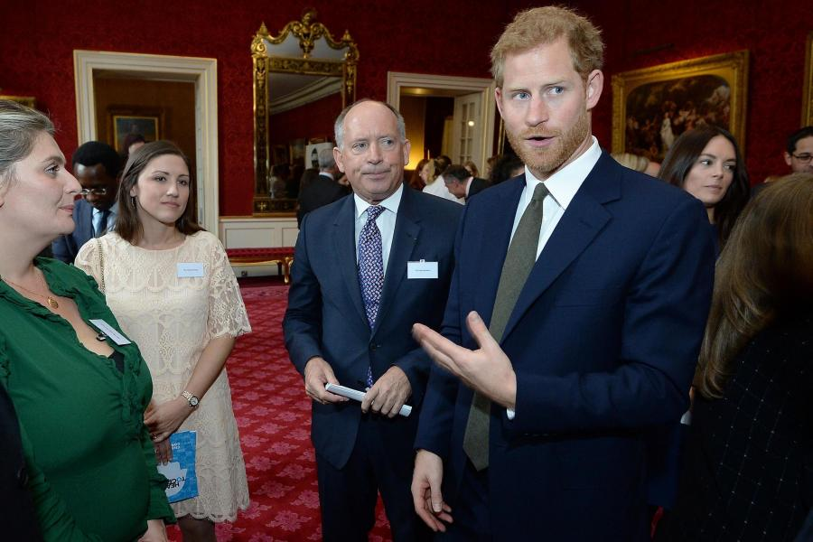 Prince Harry speaks to guests at St James' Palace, at a reception to mark World Mental Health Day. (PA)