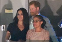 Prince Harry was pictured with Meghan Markle and her mother at the Invictus Games on Sunday Photo (C) GETTY