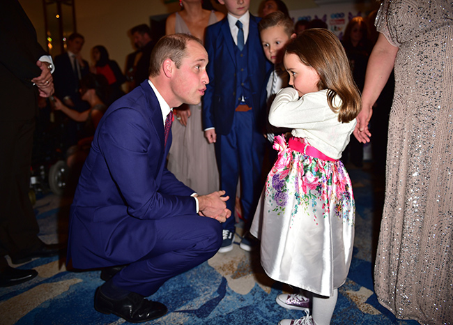 Prince William met with five-year-old Suzie McCash at the Pride of Britain Awards Photo (C) GETTY