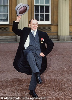 Receiving his OBE at Buckingham Palace, 1998