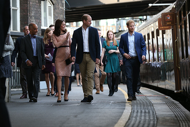 The Duchess of Cambridge joined husband Prince William, and Prince Harry at Paddington Station Photo (C) GETTY