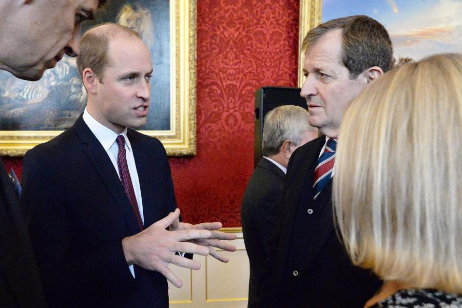 The Duke of Cambridge speaks to Alastair Campbell at the event at St James' Palace. (PA)