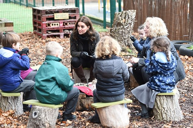 Kate, dressed in her trusty country attire, sat on a tree stump as she sat around and chatted to children about their favourite outdoor pursuits