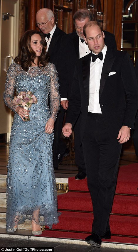 Waving to the crowds Kate and Will greet enthusiastic guests and onlookers at the Royal Variety Show at London Palladium