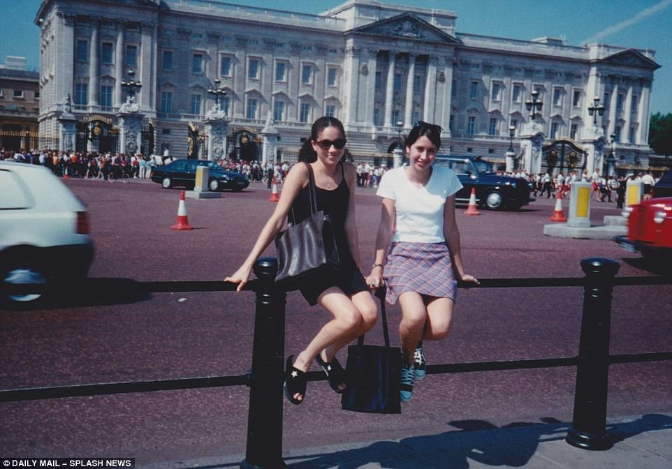 A 15 year old Meghan Markle poses in front of Buckingham Palace with friend Ninaki Priddy during a European trip in 1996