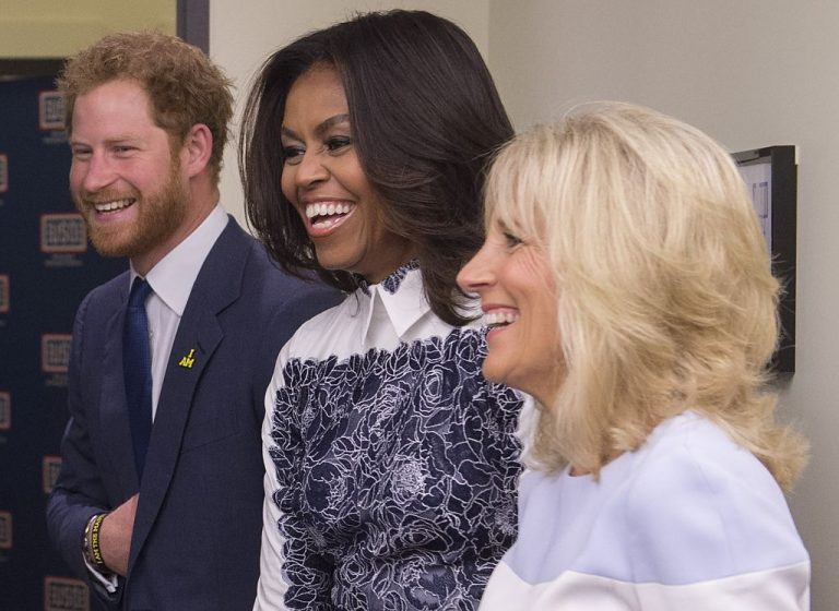Britain's Prince Harry, US First Lady Michelle Obama and Jill Biden, wife of the US Vice President, tour the USO Warrior and Family Center at Fort Belvoir, Virginia | SAUL LOEB/AFP/Getty Images