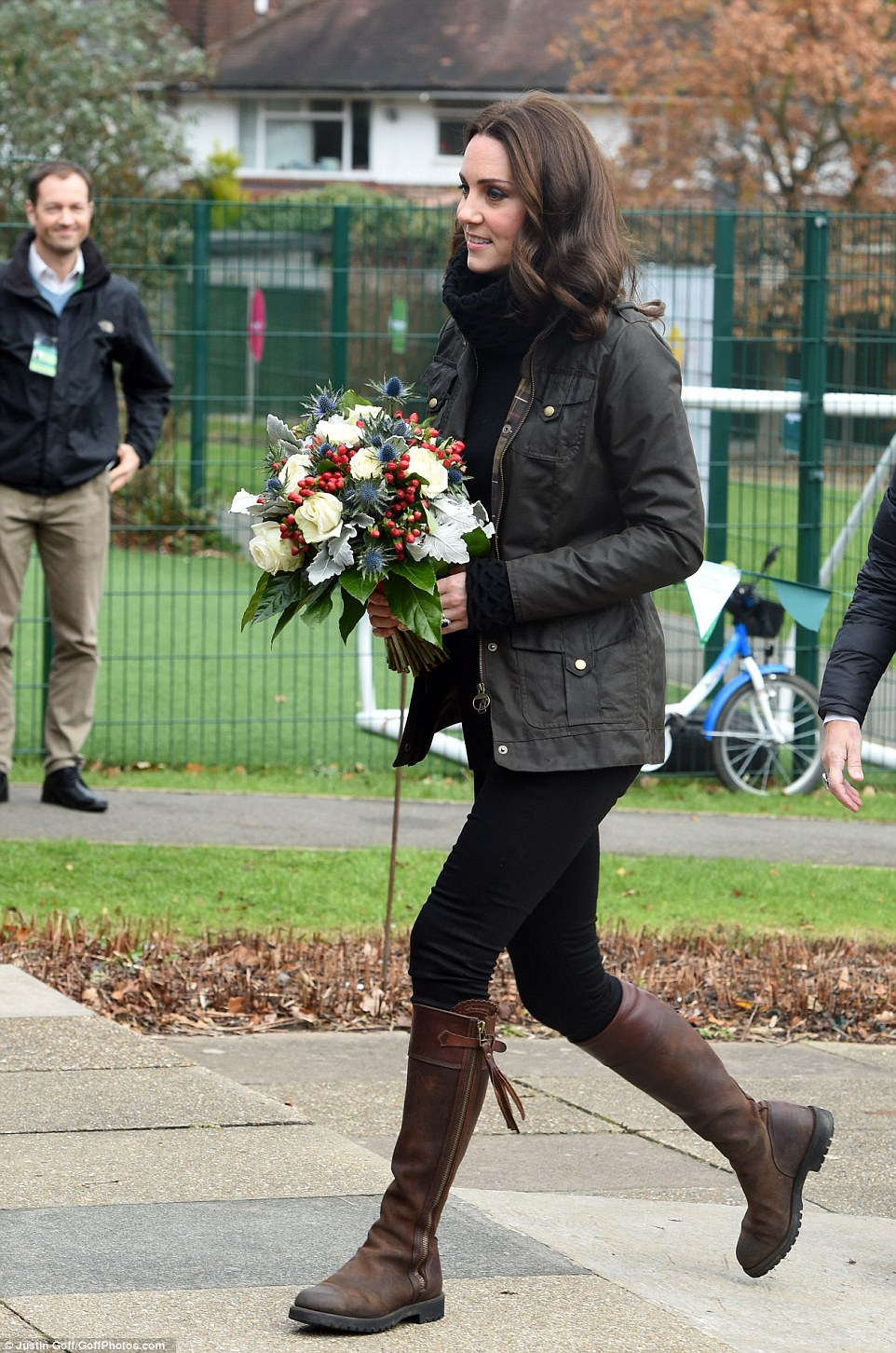 Country Kate! The pregnant Duchess of Cambridge dressed down in a Barbour jacket and her trusty boots as she arrived for a day of gardening with children in London
