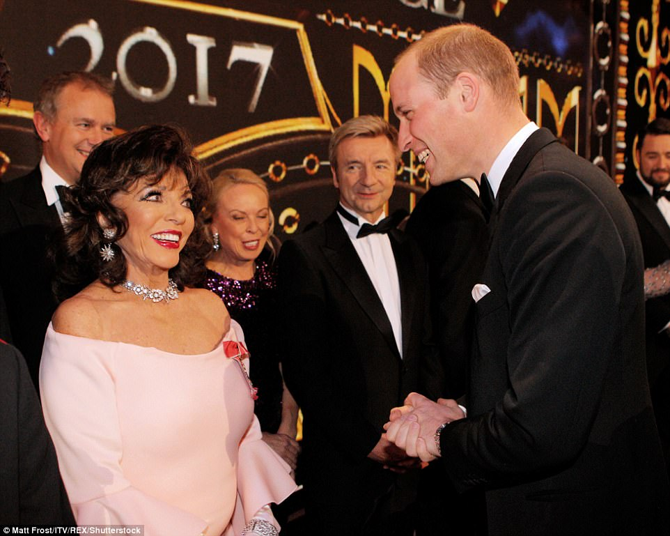 Dame Joan Collins, wearing a light pink dress and elaborate diamond jewellery, shared a warm exchange with Prince William