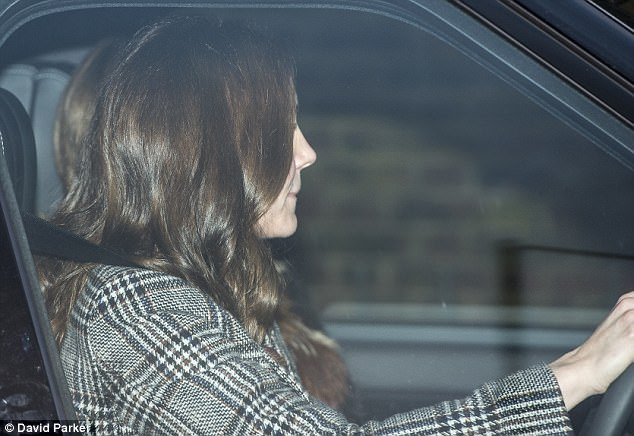 Eyes on the road The duchess appeared deep in concentration as she left the palace gates